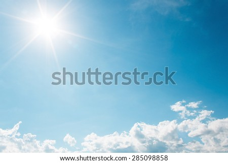 It is White Clouds on the blue sky with sun shines. - stock photo