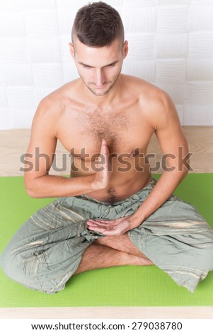 It looks like some kind of meditation. If we want to get much information about it, visit this yogi man's courses. - stock photo