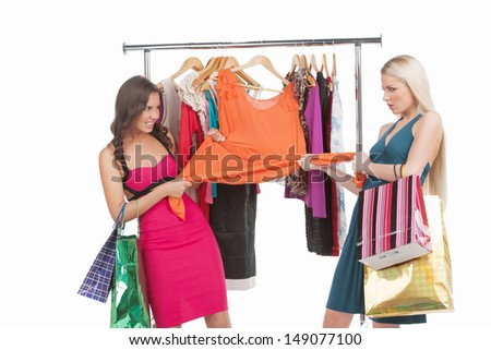 It�¯�¿�½ mine! Two angry women trying to get one dress in retail store - stock photo