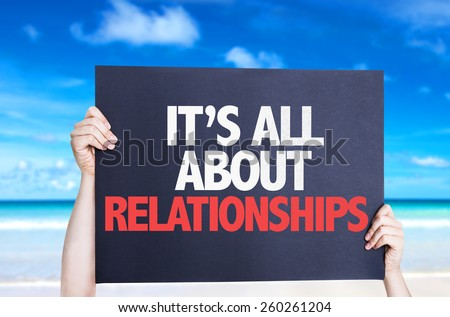 It's All About Relationships card with beach background - stock photo