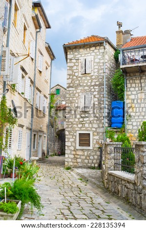 It's easy to get lost in the labyrinth of the medieval streets of Perast, Montenegro. - stock photo