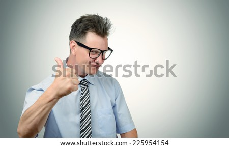 It's good! Business man in glasses with thumbs up