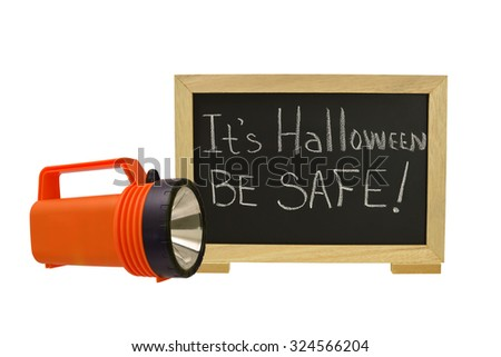 It's Halloween Be Safe!  Blackboard with orange flash light isolated on white background - stock photo