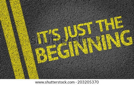 It's Just the Beginning written on the road - stock photo