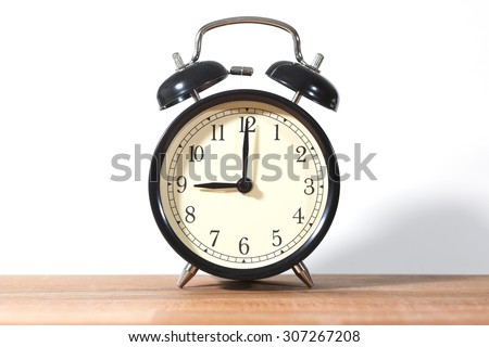 It's nine o'clock already. Time to wake up and hurry. An image of a retro clock showing 9:00 am or pm. - stock photo