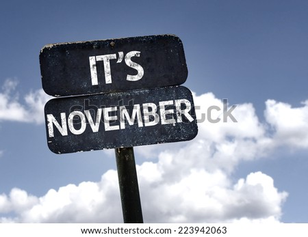 It's November sign with clouds and sky background