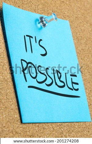 It's possible sign on blue post it paper pinned on cork bulletin board. - stock photo