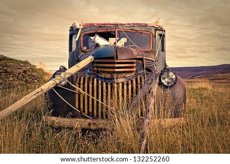 It's pretty common to find some lovely old truck left in the countryside! - stock photo