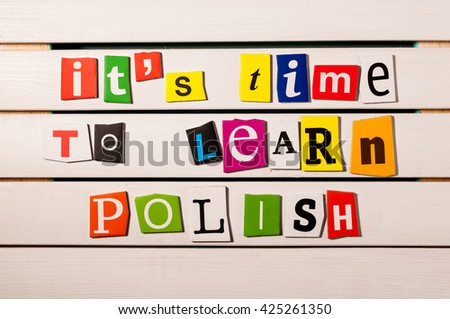 It's time to learn Polish - written with color magazine letter clippings on wooden board. Concept image