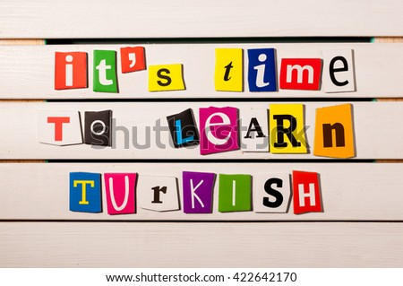 It's time to learn Turkish - written with color magazine letter clippings on wooden board. Concept  image