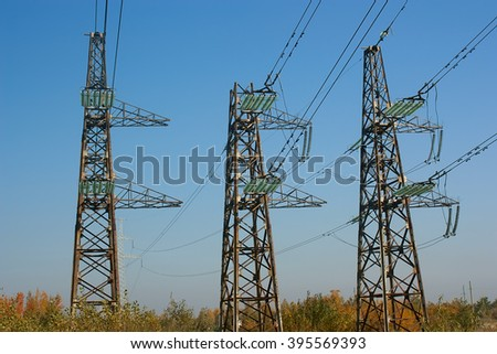 It supports three power lines against the sky