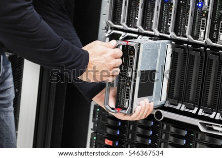 IT Technician Installing Blade Server In Chassis