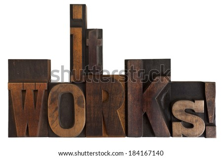 it works, phrase written in vintage wooden letterpress type, scratched and stained, isolated on white - stock photo