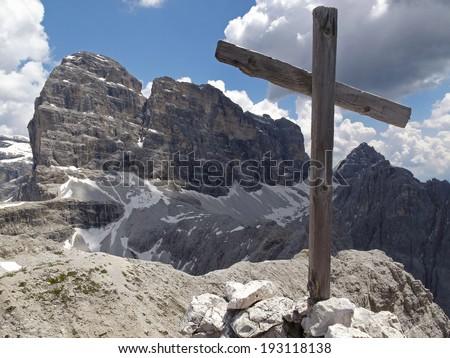 Italian Alps, wooden mountain cross in the Sesto Dolomites                                - stock photo