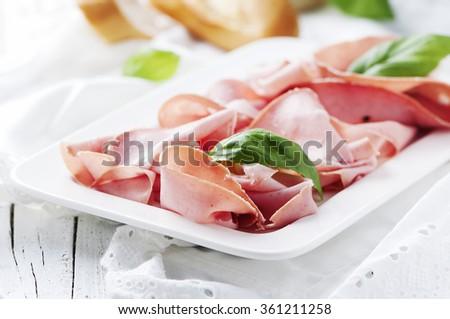 Italian antipasto with mortadella of bologna, selective focus - stock photo