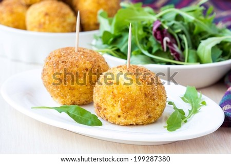 Italian appetizer arancini, rice balls stuffed with meat cooked in deep fat - stock photo