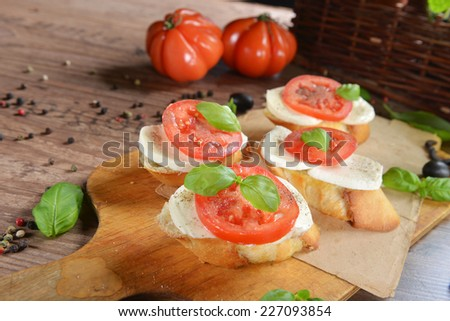 Italian Appetizer Bruschetta with Caprese Salad - stock photo