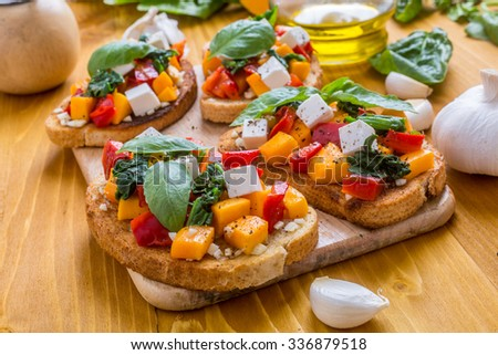 Italian Appetizer Bruschetta with roasted Pumpkin, Red Bell Pepper, Spinach, Garlic and Feta Cheese