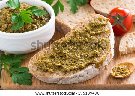 Italian appetizer - ciabatta with pesto, close-up