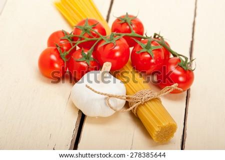 Italian basic pasta fresh ingredients cherry tomatoes garlic - stock photo