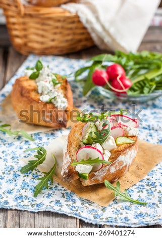Italian bread/buns Ciriola Romana. Buns for breakfast with vegetable and cheese filling - stock photo
