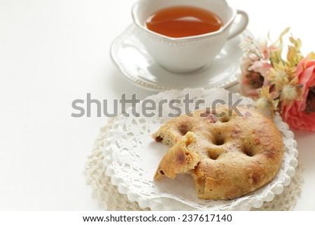 Italian bread, Dried tomato Focaccia and tea - stock photo
