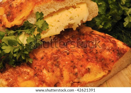 italian bread with cheese and herbs - stock photo