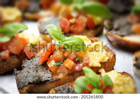 italian bruschetta with tomatoes, olive paste on a serving plate - stock photo