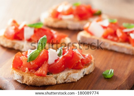 Italian bruschetta with tomatoes, parmesan, garlic and olive oil - stock photo
