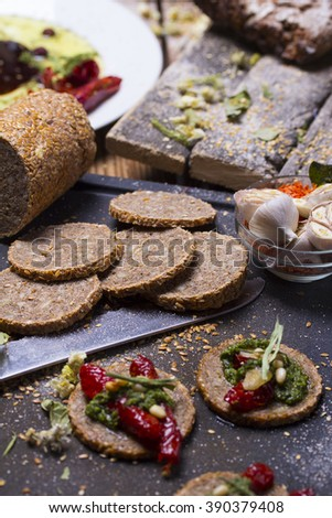 italian canapes set over rustic background - stock photo