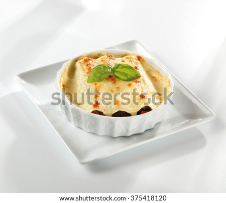 Italian cannelloni covered with a bechamel sauce 