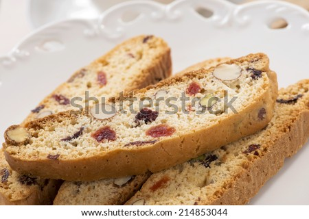 Italian cantucci in the white saucer. - stock photo