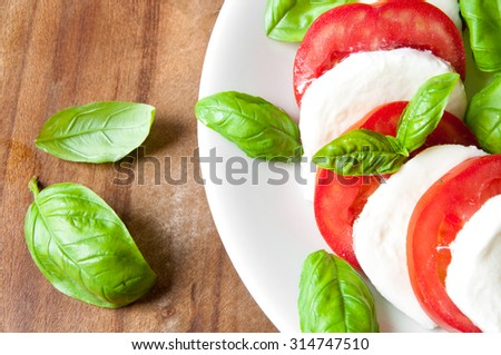 Italian Caprese Salad with Mozzarella Cheese, Tomatoes and Basil