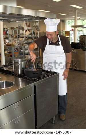 Italian chef working in the kitchen, stirring the tomatoe sauce