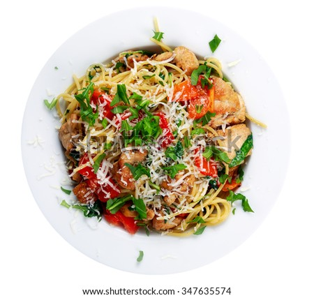 Italian Chicken Breast spaghetti with red pepper, Parmesan cheese and wild rocket  lives. isolated on white. - stock photo