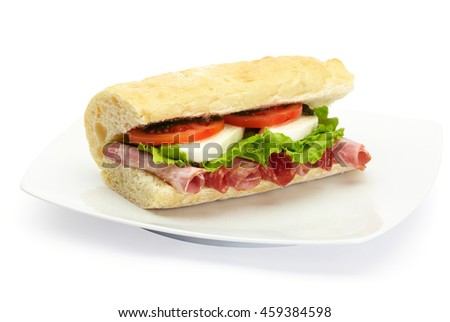 Italian ciabatta panini sandwich with salami, mozzarella, lettuce and tomato. On white plate, white background.