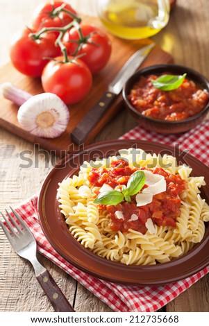 italian classic pasta fusilli with tomato sauce and basil - stock photo