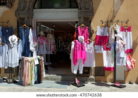 Italian clothes shop boutique with colorful summer dresses
