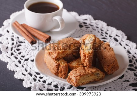 Italian cookies cantuccini with almonds and coffee with cinnamon on the table horizontal