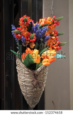 Italian cornucopia with flowers on the streets of Florence, Italy - stock photo