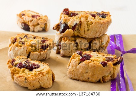 Italian crisp cookies. Biscotti with dried cranberries and nuts - stock photo