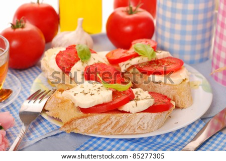 italian crostini bread with mozarella and tomato for diet breakfast - stock photo