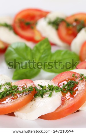 Italian cuisine Caprese salad meal with tomatoes and mozzarella cheese