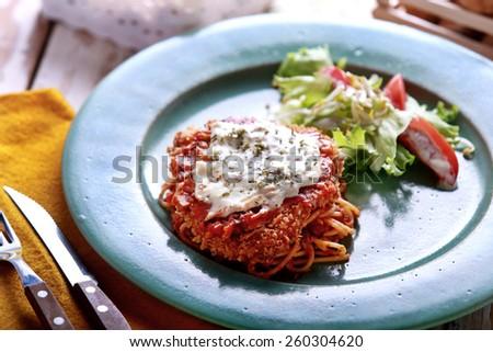 italian cuisine chicken parmigiana served with salad - stock photo