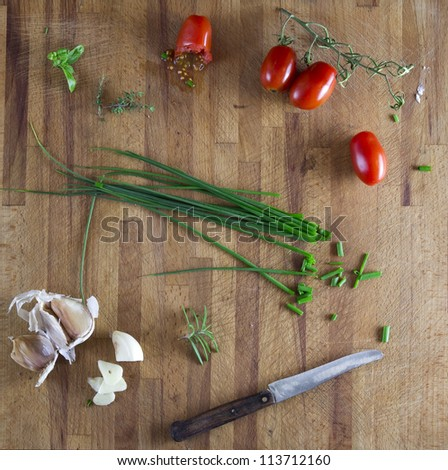italian cuisine cutting board - stock photo