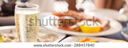 Italian cuisine. Glass of prosecco and variety of seafood. Shallow DOF, banner - stock photo