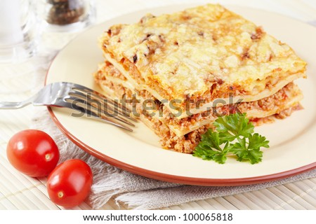 Italian cuisine. Meat lasagna  on the served table - stock photo