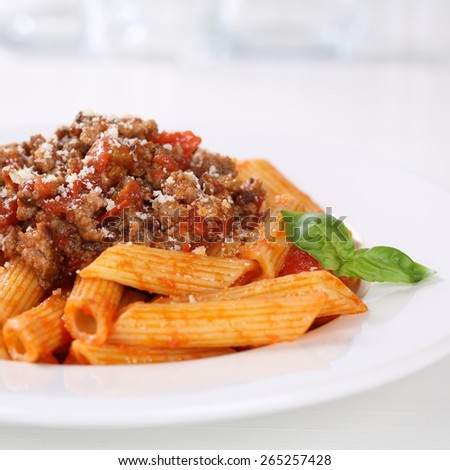 Italian cuisine penne Bolognese or Bolognaise sauce noodles pasta meal on a plate - stock photo