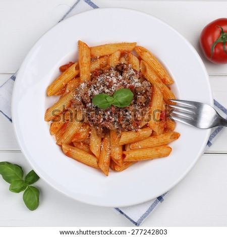 Italian cuisine penne Rigate Bolognese sauce noodles pasta meal on a plate from above