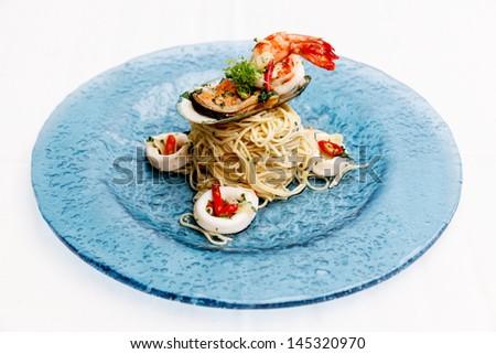 Italian cuisine spaghetti and seafood. - stock photo